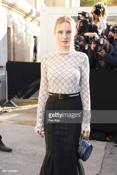 Julia Roy poses during the Chanel show as part of the Paris Fashion Week Womenswear Spring/Summer 2018 on October 3 2017 in Paris France