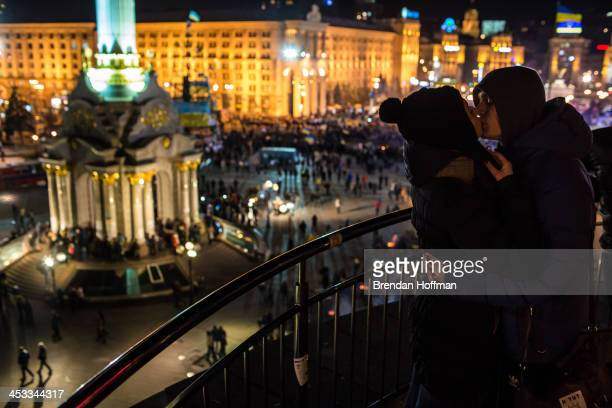 Julia Rudchenko and Vadik Kanashuk kiss during antigovernment protests in Independence Square on December 3 2013 in Kiev Ukraine Thousands of people...