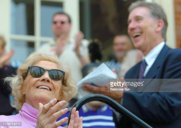 Julia Ruth Stevens daugher of Babe Ruth applauds with Babe Ruth Museum Executive Director Mike Gibbons during opening ceremonies at the Sports...