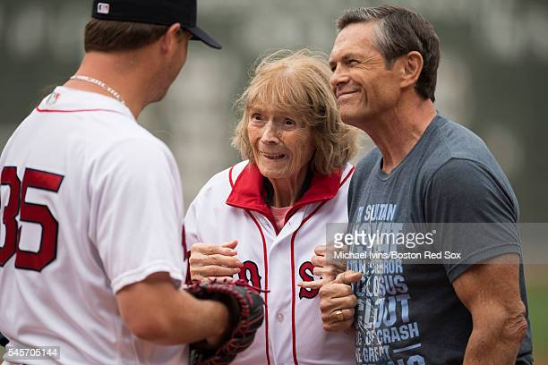 Julia Ruth Stevens the daughter of Babe Ruth is greeted by Steven Wright of the Boston Red Sox after throwing out a ceremonial first pitch on July 9...