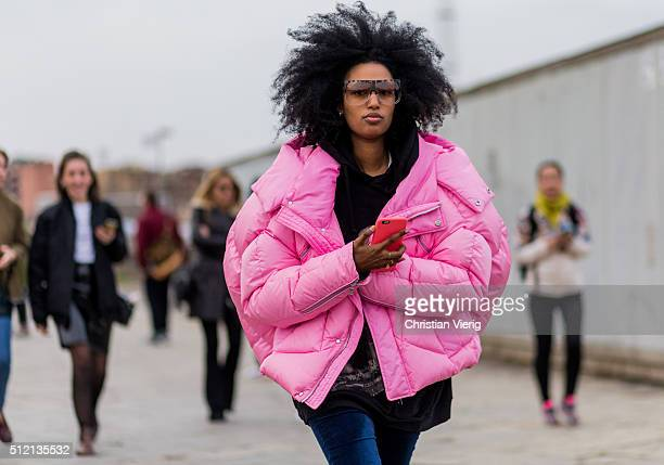 Julia Sarr Jamois wearing a pink down jacket seen outside Gucci during Milan Fashion Week Fall/Winter 2016/17 on February 24 2016 in Milan Italy
