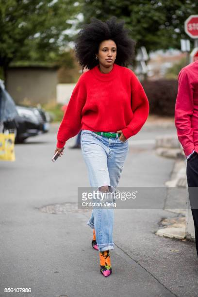 Julia Sarr Jamois wearing red knit ripped denim jeans seen outside Balenciaga during Paris Fashion Week Spring/Summer 2018 on October 1 2017 in Paris...