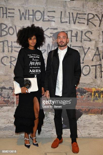Julia SarrJamois and guest attend a private view of the Basquiat exhibition cohosted by NETAPORTER in partnership with Frieze at Barbican Centre on...