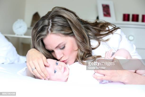 Julia Scharf 'ARD Sportschau' sport moderator poses with her baby daughter Jonna during a photo session on April 3 2017 in Munich Germany