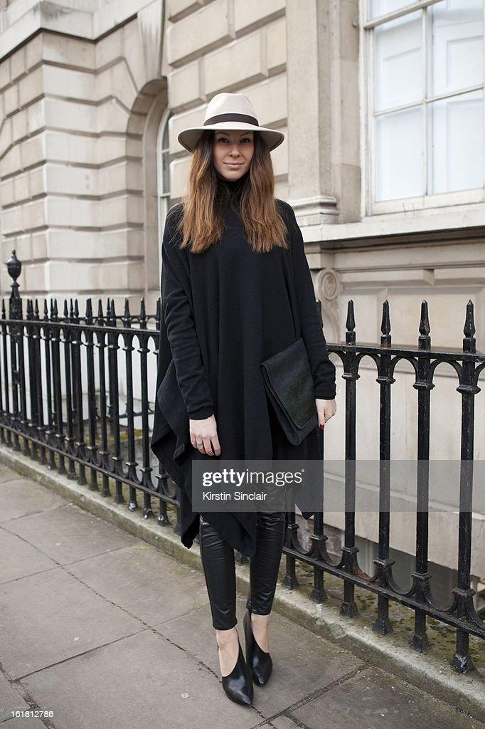 Julia Shutenko Elle fashion assistant wearing Reiss hat, All Saints top, Karl Lagerfeld trousers, Lanvin shoes, on day 2 of London Womens Fashion Week Autumn/Winter 2013 on February 16, 2013 in London, England.