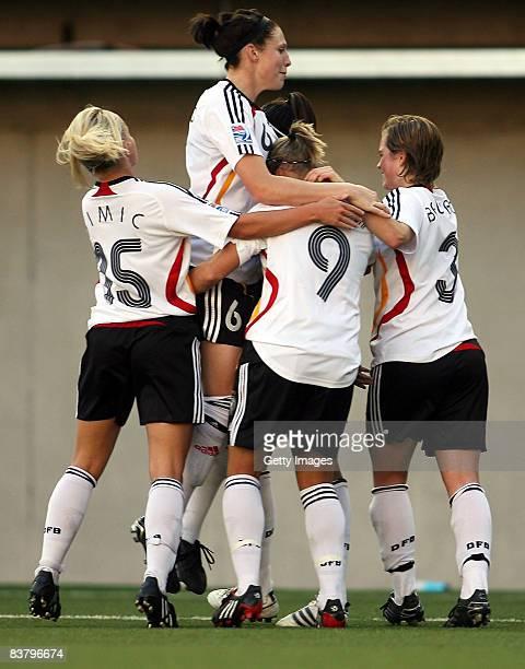 Julia Simic Kim Kulig Isabel Kerschowski Katharina Baunach of Germany celebrate after a goal during the FIFA U20 Women's World Cup match between...