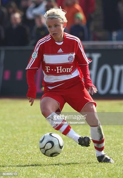 Julia Simic of Munich runs with the ball during the Women DFB Cup semi final match between Bayern Munich and FFC Frankfurt at the Sportpark Aschheim...