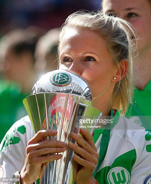 Julia Simic of Wolfsburg kisses the trophy after the women's cup final between SC Sand and VFL Wolfsburg at RheinEnergieStadion on May 21 2016 in...