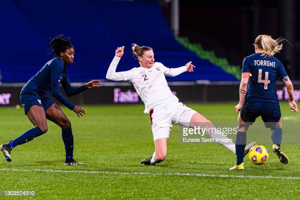 Julia Stierli of Switzerland fights for the ball with Marion Torrent of France during the friendly match between France and Switzerland at...
