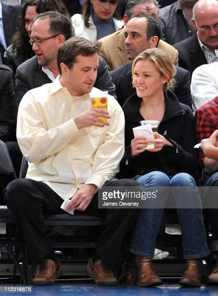 Julia Stiles and guest attend the Chicago Bulls vs New York Knicks game at Madison Square Garden on February 17 2010 in New York City