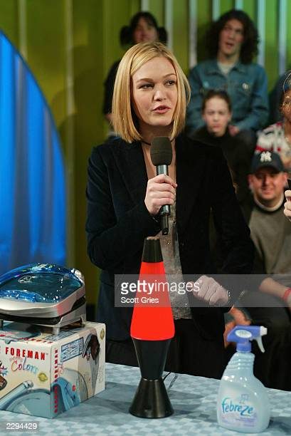 Julia Stiles shows off some college dorm room necessities during Spankin' New Band Week on TRL and MTV2 at the MTV studios in New York City January...