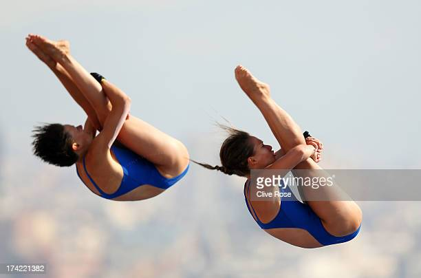 Julia Stolle and Maria Kurjo of Germany compete in the Women's 10m Platform Synchronised Diving preliminary round on day three of the 15th FINA World...