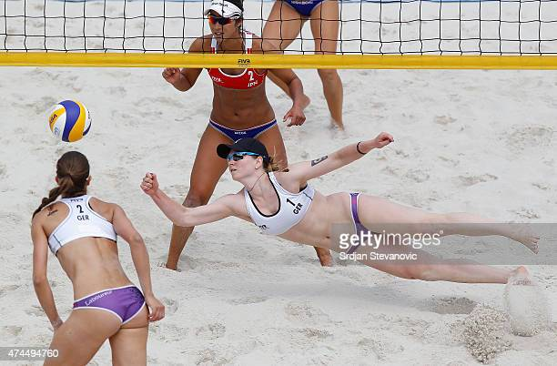 Julia Sude of Germany dives for the ball near Sayaka Mizoe of Japan during the Elimination's Round match between Julia Sude and Chantal laboureur of...