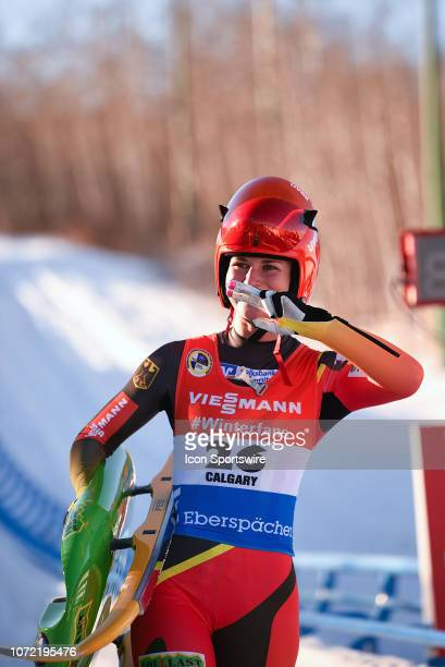 Julia Taubitz of Germany acknowledges the crowd after winning the Viessmann Luge World Cup on December 8 at the Luge Track at Winsport's Canada...