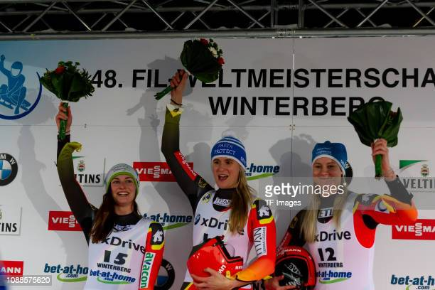 Julia Taubitz of Germany Natalie Geisenberger of Germany and Dajana Eitberger of Germany celebrates after the completes the sprint women's...
