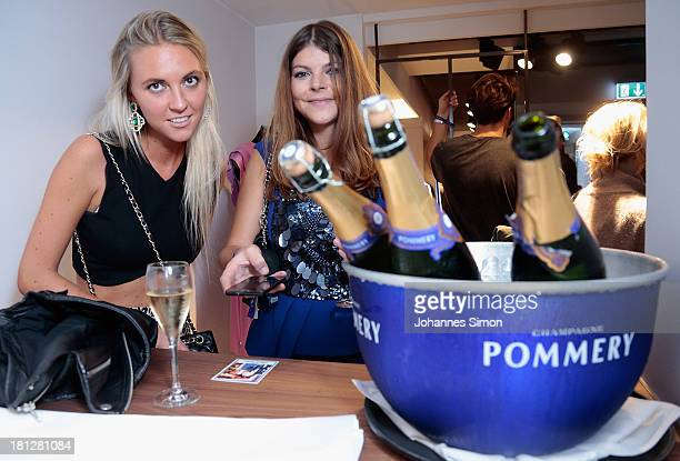 Julia Tewaag and guest attend the Laurel Flagship Store Opening on September 19 2013 in Munich Germany