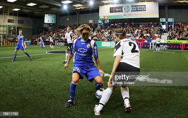 Julia Thinius of Bad Neuenahr fights Leni Larsen Kaurin of Potsdam during the Women's Indoor THome Cup match between 1FFC Turbin Potsdam and SC 07...