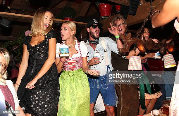 Julia Trainer Julia Josten Manuel Cortez Martin Krug during Oktoberfest at Kaeferzelt/Theresienwiese on September 27 2014 in Munich Germany