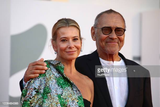 Julia Vysotskaya, Andrei Konchalovsky walk the red carpet ahead of closing ceremony at the 77th Venice Film Festival on September 12, 2020 in Venice,...