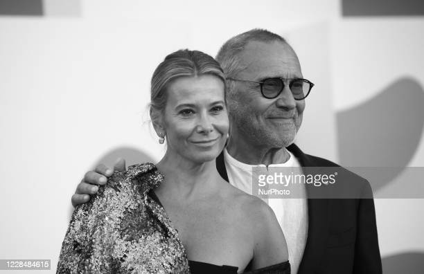 Image was converted to black and white) Julia Vysotskaya, Andrei Konchalovsky walk the red carpet ahead of closing ceremony at the 77th Venice Film...