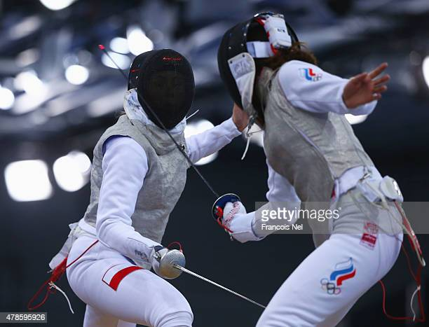 Julia Walczyk of Poland and Adelina Zagidullina of Russia compete during the Women's Team Foil semi final during day fourteen of the Baku 2015...