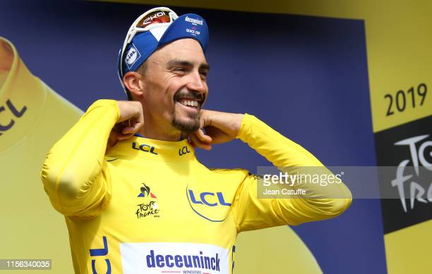 Julian Alaphilippe of France and DeceuninckQuick Step retains the yellow jersey of leader of the race during the podium ceremony following stage 12...