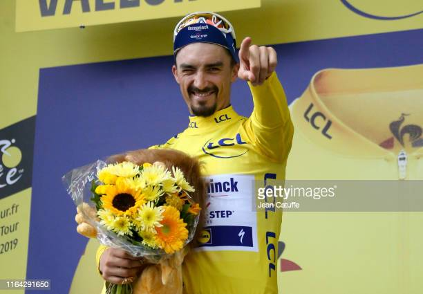 Julian Alaphilippe of France and DeceuninckQuick Step retains the yellow jersey of leader of the race during the podium ceremony following stage 18...