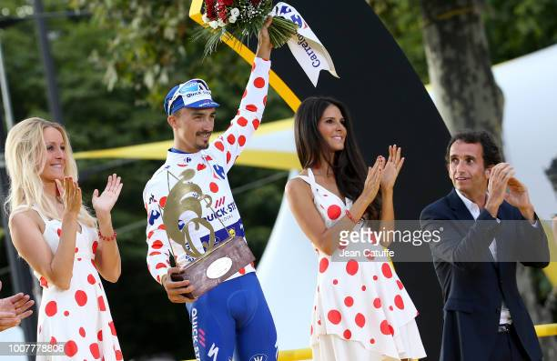 Julian Alaphilippe of France and Quick Step Floors winner of polka dot jersey for best climber receives the trophy from CEO of Carrefour Alexandre...