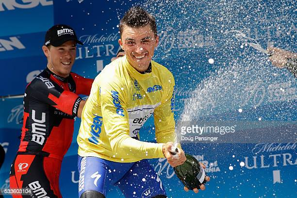Julian Alaphilippe of France riding for Etixx QuickStep celebrates on the podium with champagne in the overall race leader's jersey with second place...