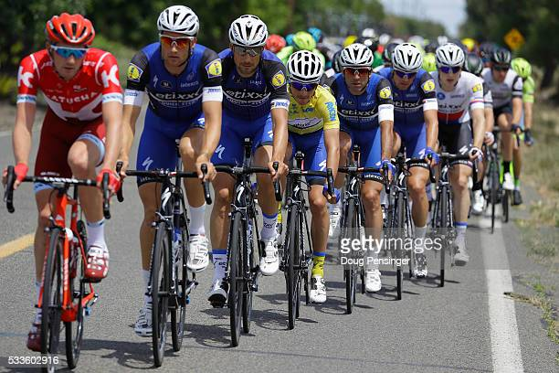 Julian Alaphilippe of France riding for Etixx QuickStep defends the overall race leader's yellow jersey as he rides in the protection of his...