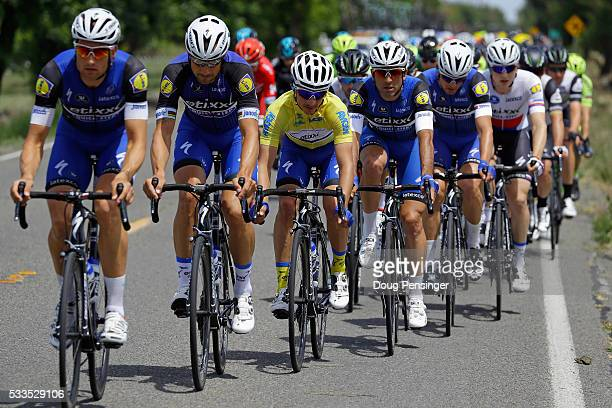 Julian Alaphilippe of France riding for Etixx QuickStep rides in the protection of his team as he defends the overall race leader's jersey in stage...