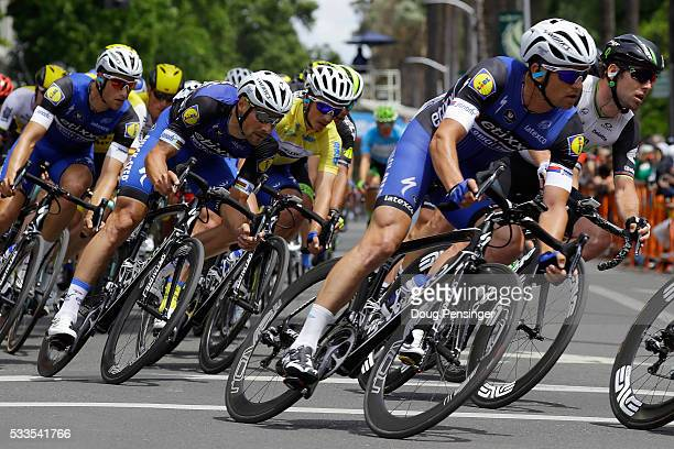 Julian Alaphilippe of France riding for Etixx QuickStep rides in the protection of teammate Tom Boonen of Belgium as he defends the overall race...