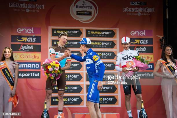 Julian Alaphilippe of the Deceuninck team winner with Oliver Naesen of AG2R La Mondiale second and Michal Kwiatkowski of Team Sky third are seen on...
