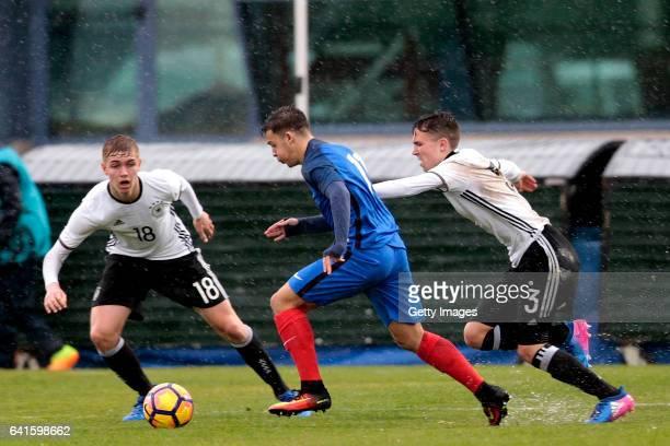 Julian Albrecht and Oscar Schönfelder of Germany U16 challenge Bilel Hassaini of France U16 during the UEFA Development Tournament Match between...