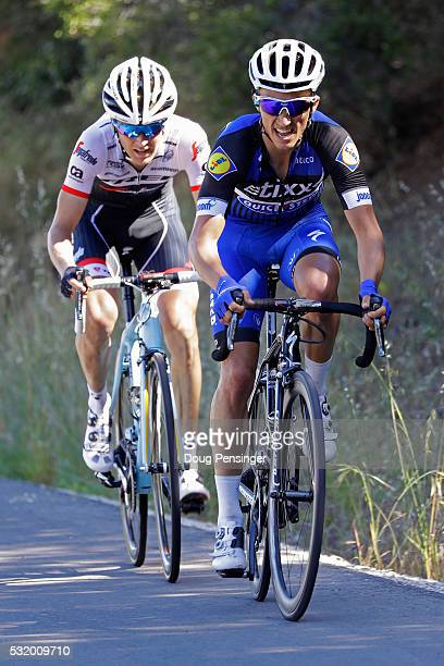 Julian Alphilppe of France riding for Ettix QuickStep passes Peter Stetina of the United States riding for TrekSegafredo in the final kilometer as he...