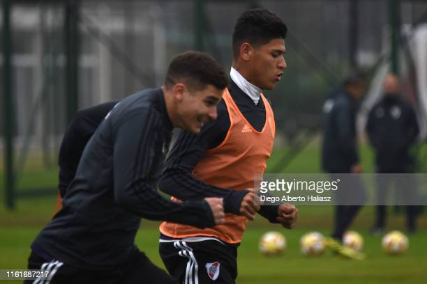 Julian Alvarez and Jorge Carrascal of River Plate warms up during a training session at River Camp on July 12 2019 in Ezeiza Argentina
