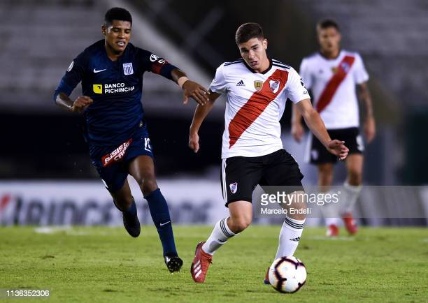 Julian Alvarez of River Plate fights for the ball with Wilder Cartagena of Alianza Lima during a group A match between River Plate and Alianza Lima...