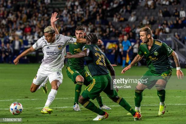 Julian Araujo of Los Angeles Galaxy controls the ball during the game against Portland Timbers at the Dignity Health Sports Park on October 16, 2021...