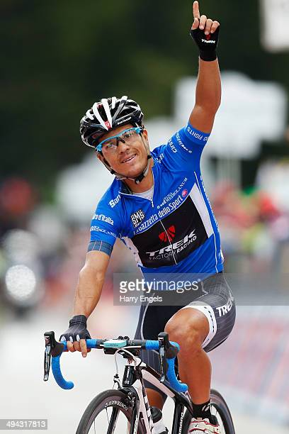 Julian Arredondo of Colombia and team Trek Factory Racing celebrates crossing the finish line to win the eighteenth stage of the 2014 Giro d'Italia,...