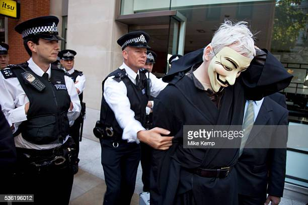 Julian Assange at the Occupy London demonstration 15th October 2011 Seen here after arriving in a taxi with his own security he tries to get through...
