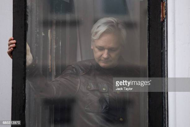 Julian Assange leaves after speaking to the media from the balcony of the Embassy Of Ecuador on May 19 2017 in London England Julian Assange founder...