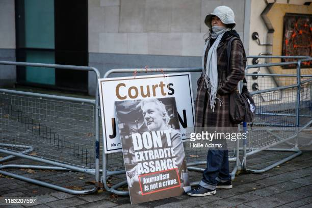 Julian Assange supporter demonstrates outside of the Westminster Magistrates Court on November 18 2019 in London England