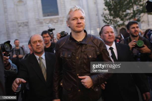 Julian Assange the founder of the WikiLeaks website arrives to speak to protesters outside St Paul's Cathedral during the 'Occupy London' protest on...