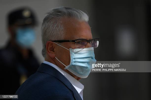 Julian Assange's Spanish lawyer Baltazar Garzon wears a face mask before talking to the press after appearing in court in Madrid on July 27 2020...