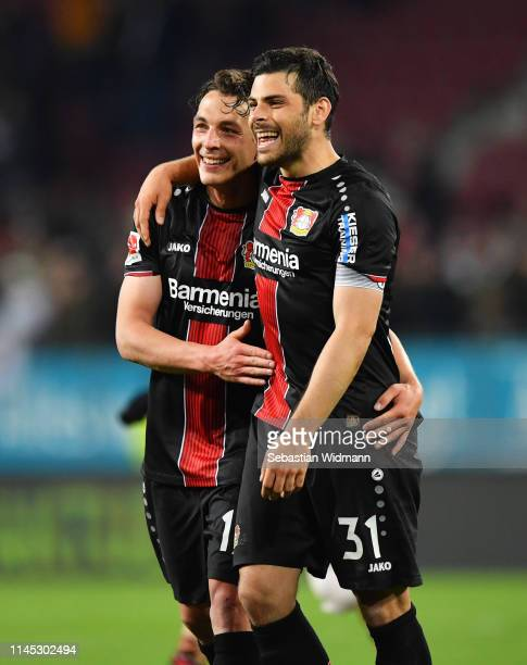 Julian Baumgartlinger and Kevin Volland of Bayer 04 Leverkusen celebrate victory after the Bundesliga match between FC Augsburg and Bayer 04...