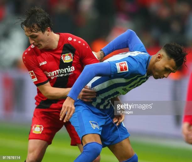 Julian Baumgartlinger of Leverkusen and Davie Selke of Berlin battle for the ball during the Bundesliga match between Bayer 04 Leverkusen and Hertha...