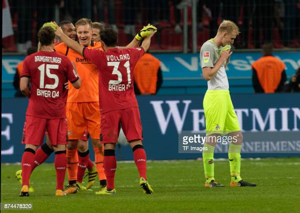 Julian Baumgartlinger of Leverkusen Goalkeeper Bernd Leno of Leverkusen and Kevin Volland of Leverkusen celebrate after winning and Frederik...