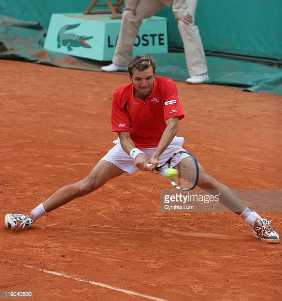 Julian Beneteau of France defeats Marcos Baghdatis of Cyprus 36 64 63 67 64 in the second round of the 2006 French Open at Roland Garros Stadium in...