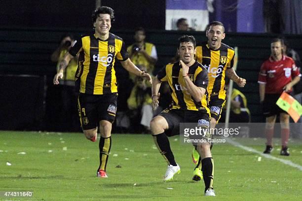 Julian Benitez Federico Santander and Luis De La Cruz of Guarani celebrate the first goal of his team scored by Julian Benitez during a first leg...
