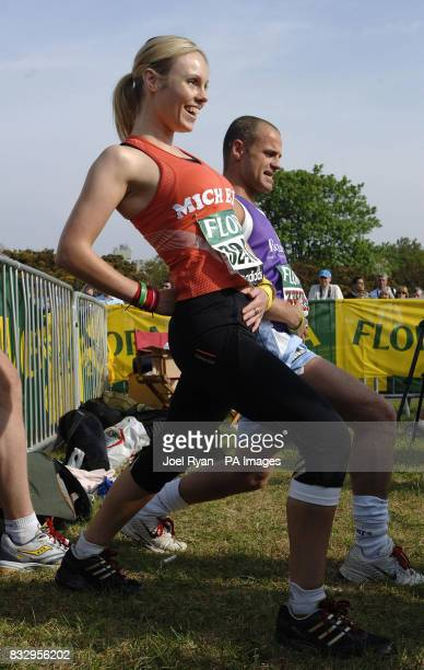 Julian Bennett and Apprentice winner Michelle Dewberry stretch at the start of the Flora London Marathon in Greenwich London